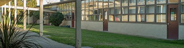 outdoor campus hallway with grass center